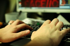 Photo of female hands typing on a computer keyboard