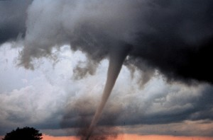 IMAGE A large and powerful tornado funnel looms in the sky. IMAGE