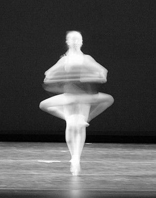 IMAGE A blurred figure is captured in a pirouette. IMAGE