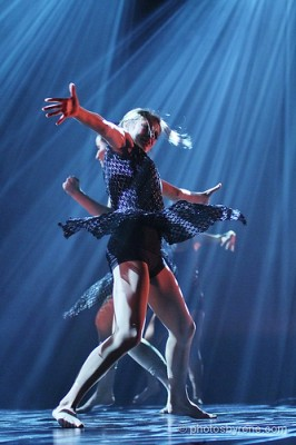 IMAGE Rays of light surround a dancer in action IMAGE