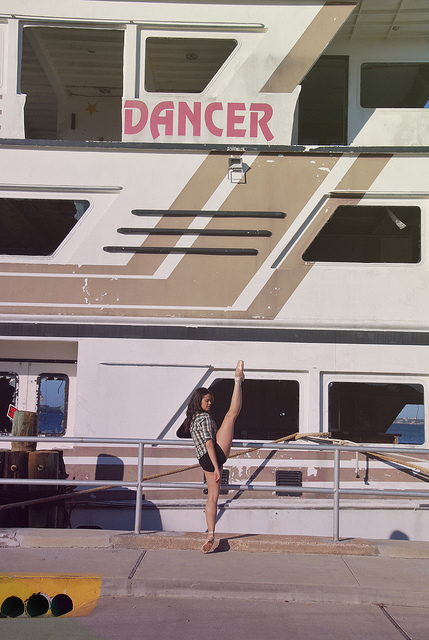 Photo of a dancer in front of a ship called Dancer