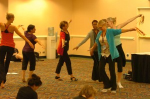 Beverly Spell leading teachers in a circle with ribbon rings at DTS 2010
