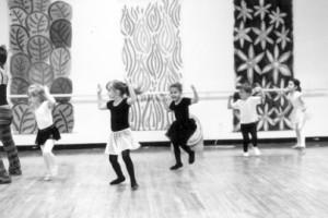 Black and white photo of children dancing