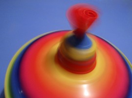 Close-up of a spinning toy top