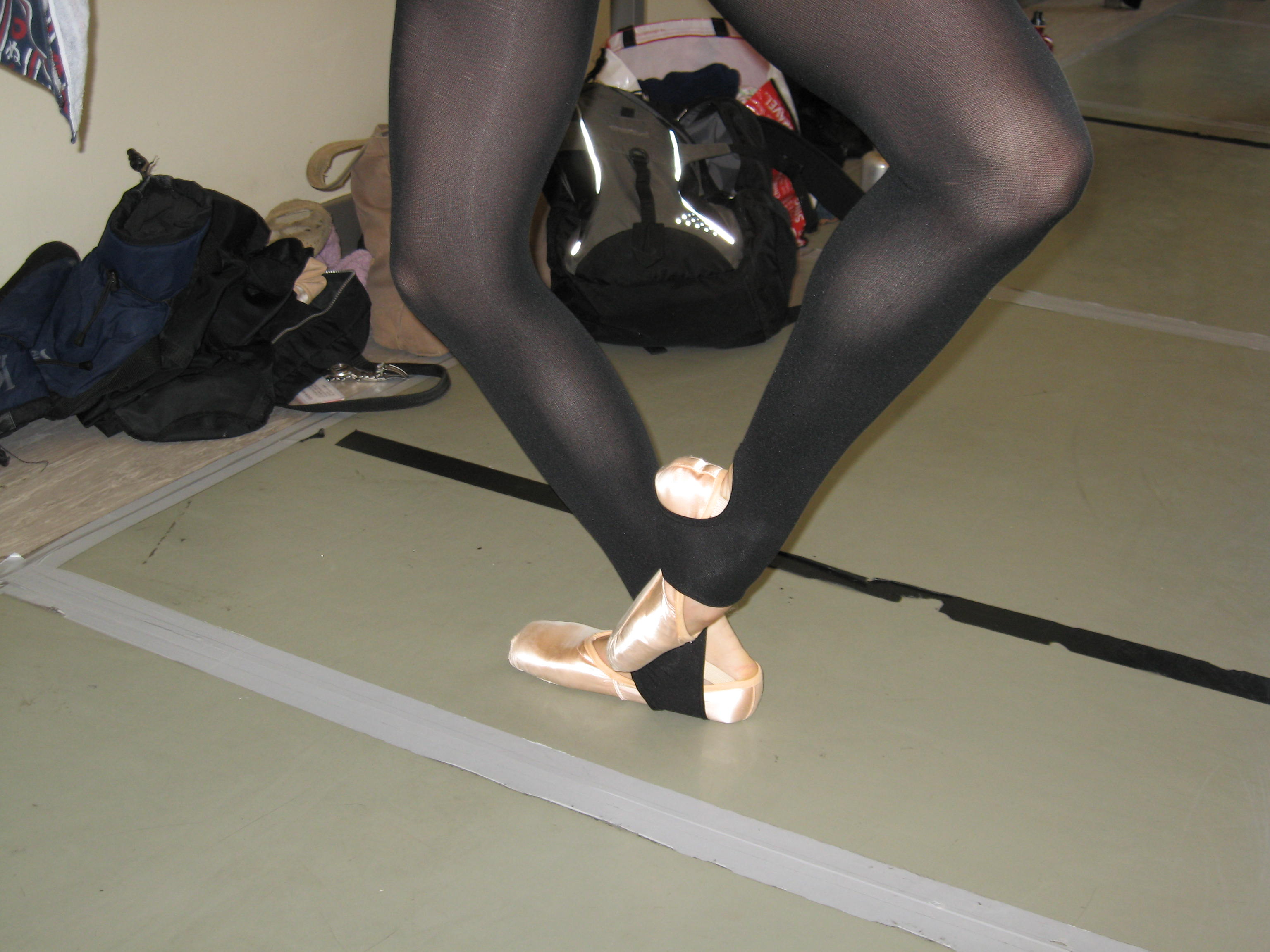Cou-de-pied in black ballet tights