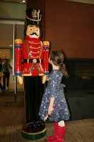 [image] Little girl with a large nutcracker statue [image]