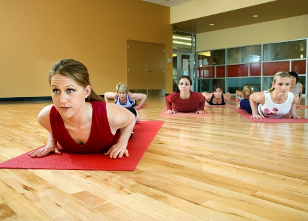 Women participate in a yoga fitness class