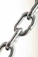 IMAGE Close-up of metal chain links against a white background. IMAGE
