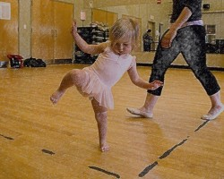 IMAGE A toddler balances on one foot in her creative dance class. IMAGE