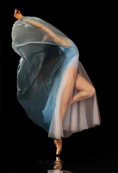 IMAGE A ballet dancer in white chiffon arches her back as sheer blue fabric billows back over her face and arms. IMAGE