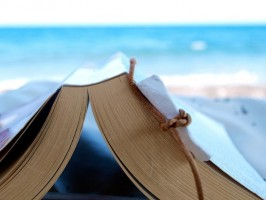 IMAGE Reading a book at the beach IMAGE