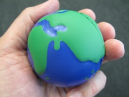 IMAGE An 'Earth' stress ball is held gently in someone's hand. IMAGE