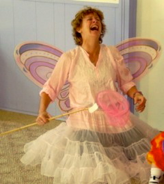 IMAGE Alexandra of Hullabaloo Danceshop looks jovial in butterfly wings as she waves a magic wand over her creative dance class. IMAGE