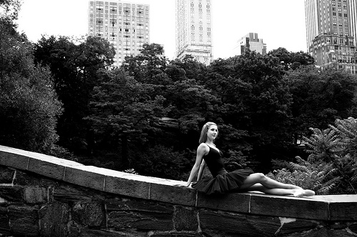 IMAGE A ballet dancer lounges on a stone wall in Central Park, New York City. IMAGE
