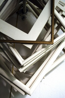 IMAGE A pile of empty, wooden frames. IMAGE