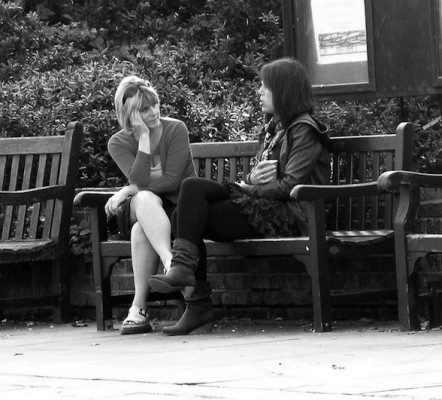 IMAGE A daughter has a heart to heart conversation with her mom. IMAGE