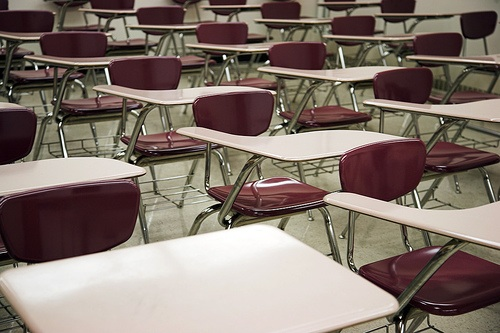 IMAGE Rows of empty desks for test-taking IMAGE