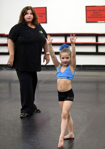 IMAGE Abby Lee Miller of Dance Moms with a student IMAGE