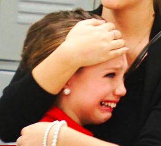 IMAGE A young dancer sheds tears during an episode of Dance Moms IMAGE