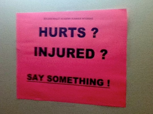 IMAGE A sign encouraging dance students to report their injuries IMAGE