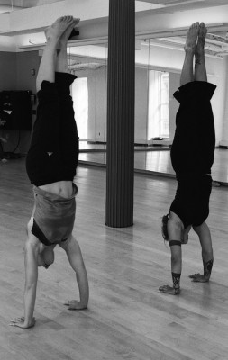 IMAGE Two dancers test each other in a handstand contest. IMAGE
