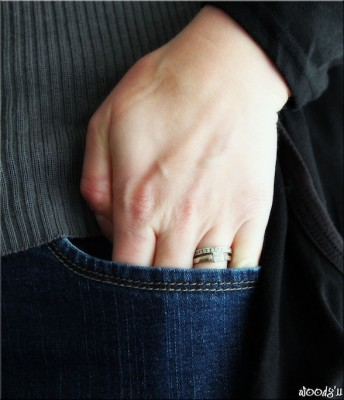 IMAGE A woman's hand slips into her pocket IMAGE