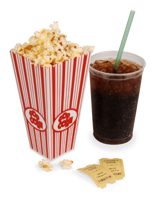 IMAGE A box of popcorn, soda, and two tickets IMAGE