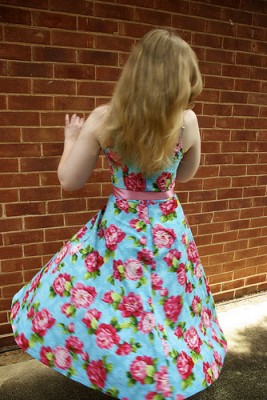 IMAGE A girl twirls in a pretty rose-print dress. IMAGE