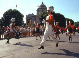 IMAGE A drum major bounds down the parade route IMAGE