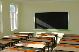 IMAGE An empty classroom with desks and a chalkboard IMAGE