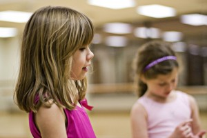 IMAGE Two young dancers wearing pink in ballet class IMAGE